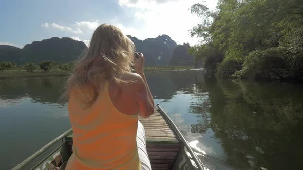 Thumbnail for View of Blond Woman with Camera on the Boat. Excursion in Halong Bay, Boat Island Tours. Hanoi