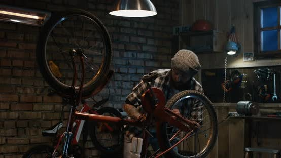 Thumbnail for Man Using a Tablet in a Bicycle Repair Shop