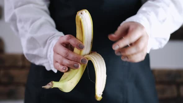The Chef Is Peeling a Banana From a Skin