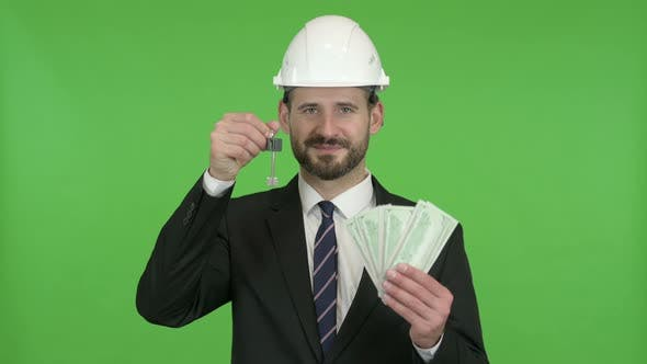 Cheerful Engineer with House Key and Money Against Chroma Key