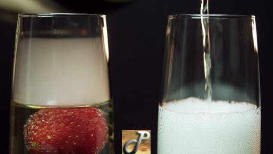 Thumbnail for Champagne Poured With Strawberry