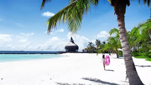 Little girl playing on the ocean beach