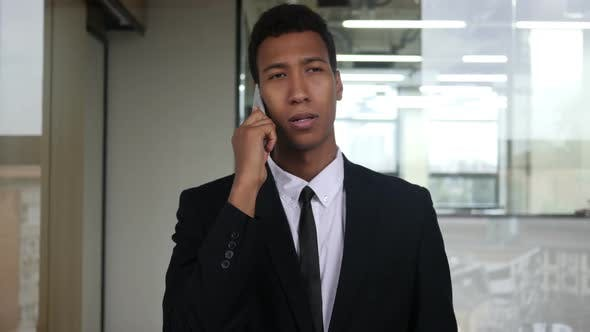 Thumbnail for Black Businessman Phone Negotiation, Dialing and Talking