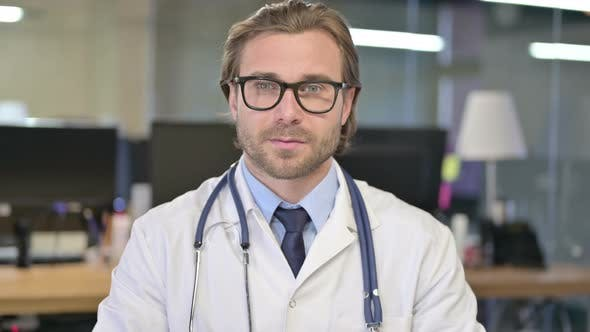 Thumbnail for Portrait of Serious Doctor Looking at Camera