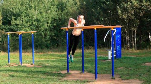 Girl Training on Parallel Bars