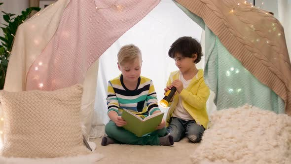 Thumbnail for Happy Boys Reading Book in Kids Tent at Home