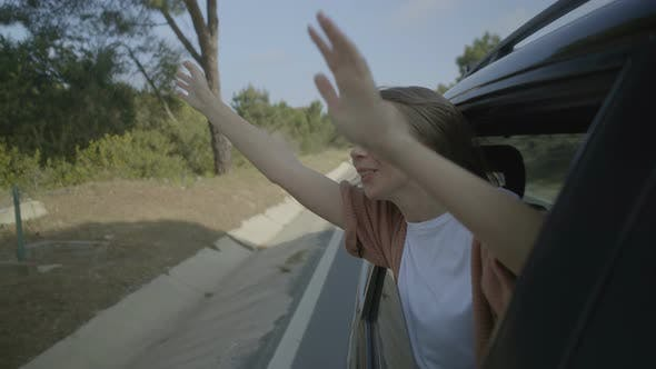 Thumbnail for Girl Sitting in Car and Raising Hands
