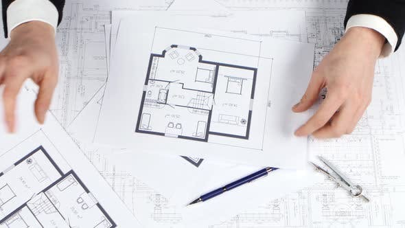 Thumbnail for Investor Looks at the Blueprints of the Building for Investment. Close Up