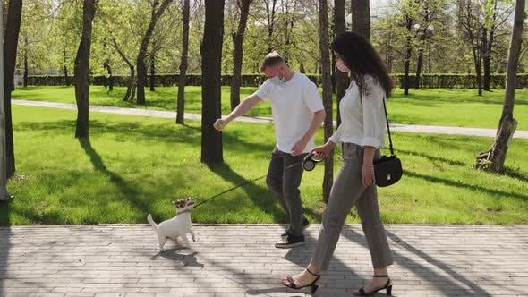 Thumbnail for Woman and Man Walking their Dog in Park during Pandemic