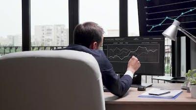 Businessman Analyzing Sales Pattern