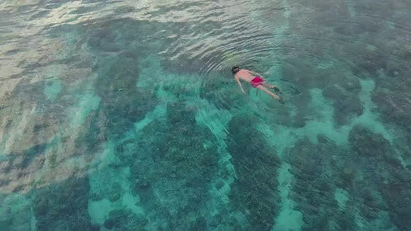 Thumbnail for Snorkler Swimming in Blue Ocean, Aerial
