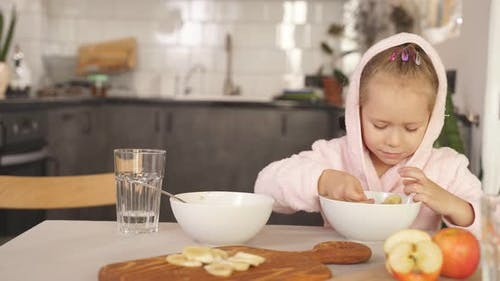 Cute Little Girl After Shower Dressed Bathrobe Having Breakfast Kitchen Sitting Table Child Eats