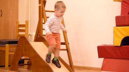 Boy Playing in the Nursery