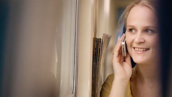 Thumbnail for Woman Talking on the Phone in the Train