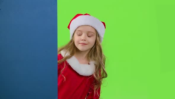 Thumbnail for Child Girl Peeking Out From Behind the Blue Board. Green Screen