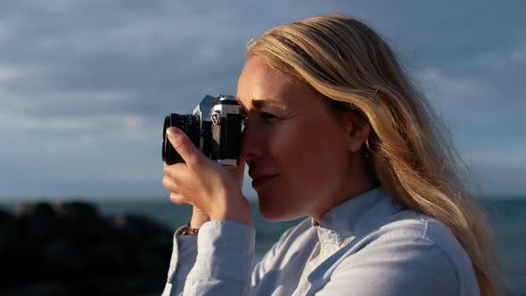Thumbnail for Photographer Focusing Slr Camera