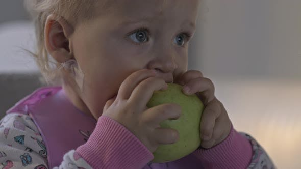 Thumbnail for Baby Girl Having a Snack with Apple