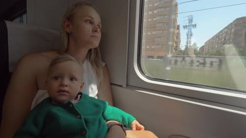 Baby Girl Traveling with Mum By Train