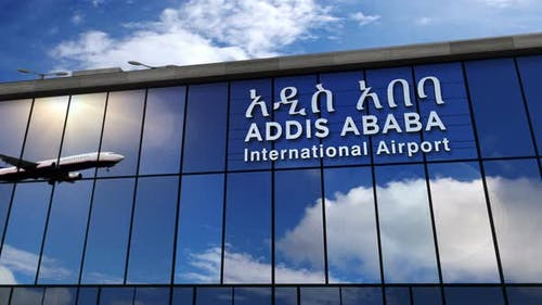 Airplane landing at Addis Ababa Ethiopia airport mirrored in terminal