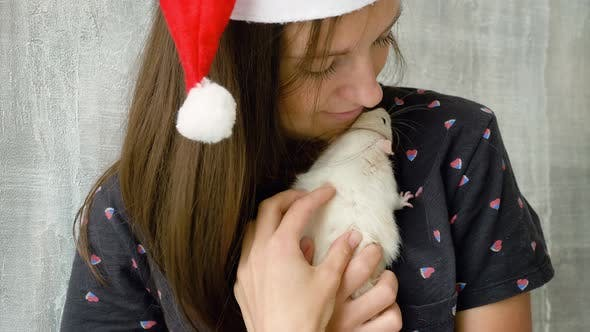 Thumbnail for Woman in Red Christmas Cap with White Rat