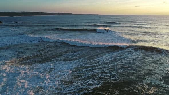 Thumbnail for Aerial View on Big Ocean Waves and Sunset Sky