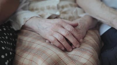 Close View of Putting Old Exhausted Female Hands on Hands Together at Camera