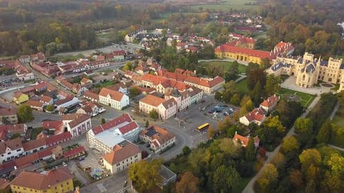 Aerial view of small town and green gardens in Lednice castle Chateau yard in Moravia, Czech
