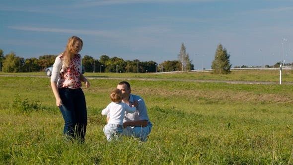 Cover Image for Family Of Three Having Fun Outdoors