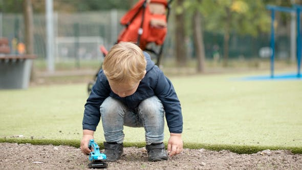 Thumbnail for Boy Playing With Toy Outdoor