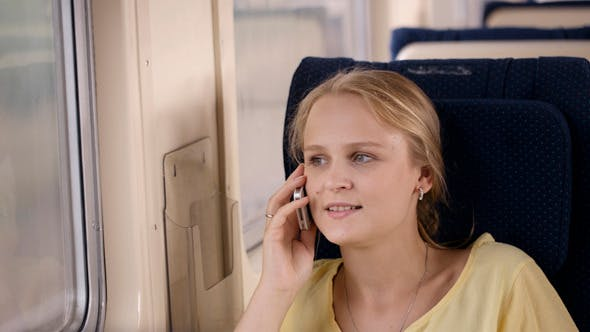 Thumbnail for Woman Talking on the Phone in the Train 2