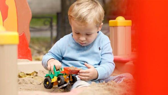 Thumbnail for Boy Playing With Toy on Playground