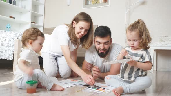 Young Parents Developing Their Kid's Painting Skills