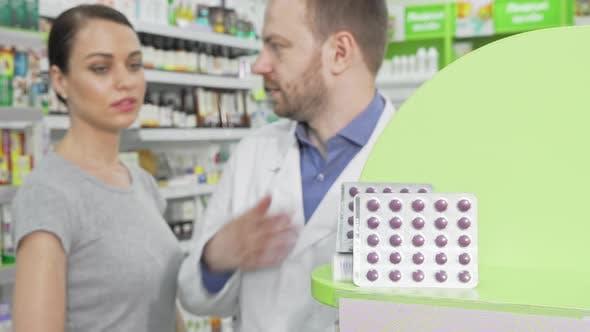 Thumbnail for Male Pharmacist Offering His Female Customer Pills in Blister