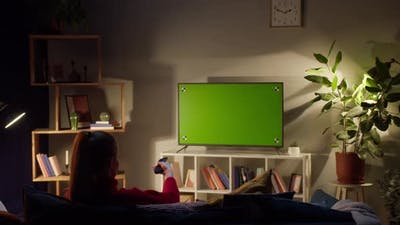 Woman Watching Television with Chroma Green Screen