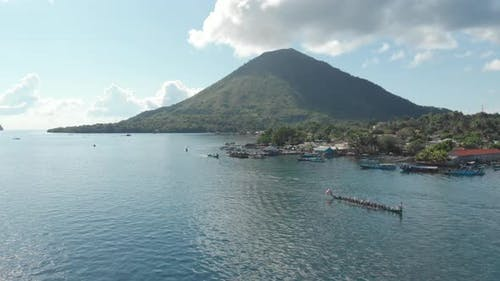 Aerial: kora-kora traditional canoe annual race in Banda Islands Indonesia
