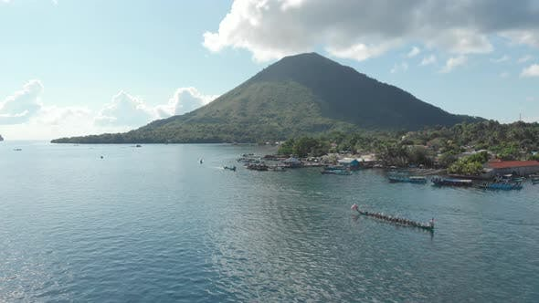 Thumbnail for Aerial: kora-kora traditional canoe annual race in Banda Islands Indonesia