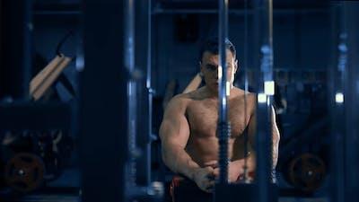 Bodybuilder Resting Near the Gym in the Gym