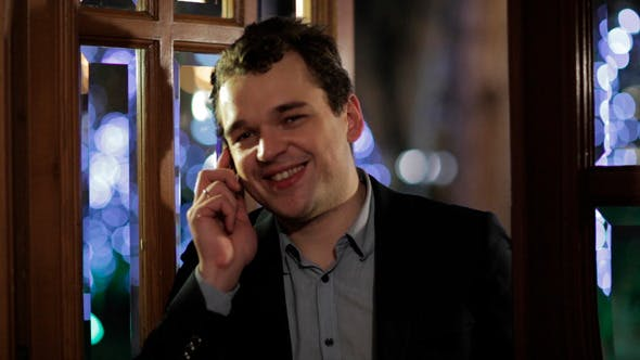 Thumbnail for Man Smiling Happily As He Chats on His Mobile