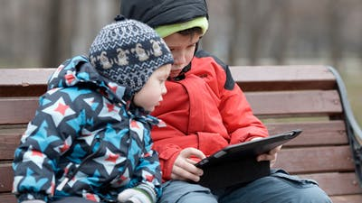Brothers With Tablet Computer