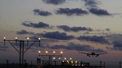 Flight Airline Landing at Sunset