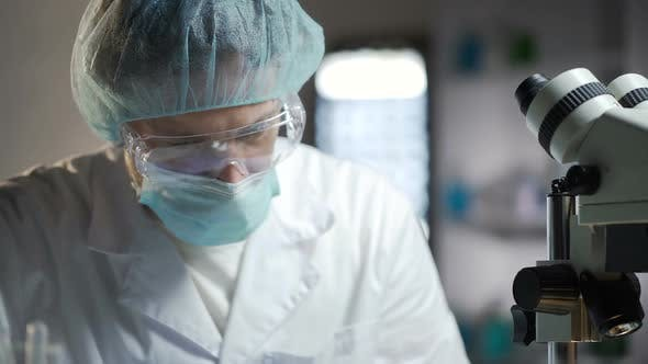 Thumbnail for Male Medical Analyst Nervously Waiting for Results of His Scientific Experiments