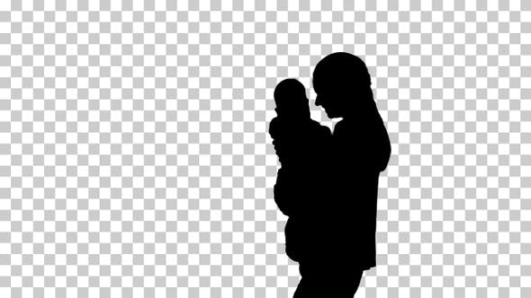 Thumbnail for Silhouette mother holding her baby in hands and walking
