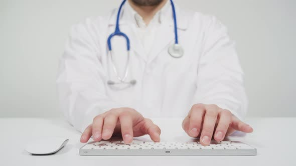 Cover Image for Doctor typing on keyboard