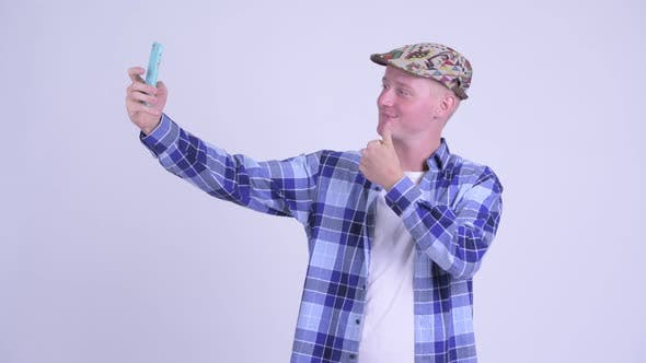 Cover Image for Happy Young Handsome Hipster Man Taking Selfie