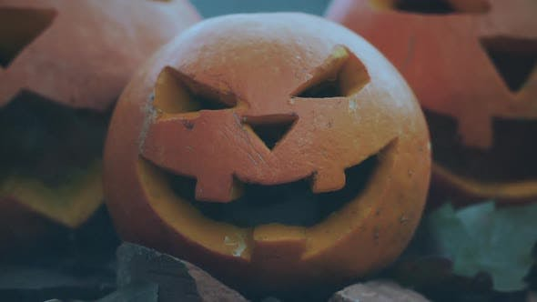 Cover Image for Halloween spooky pumpkins with scary carved faces
