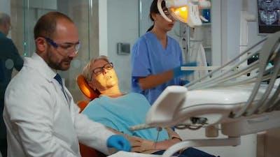 Orthodontist Lighting the Lamp Until Examination