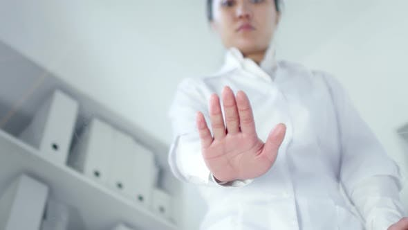 Female Scientist Pressing Palm on Interactive Transparent AR Screen