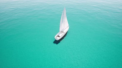 Aerial View Yacht Sailing on Opened Blue Clear Ocean