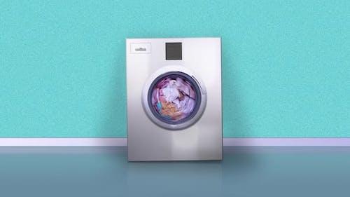 Machine Bounces From Vibration Washing Laundry at Azure Wall