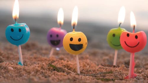 Smiley candles on the beach